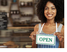 woman with store open sign